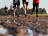 Runners in Mud